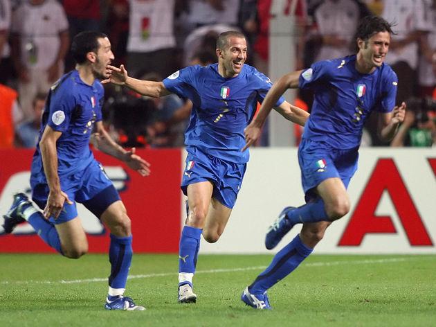 Italian defender Fabio Grosso (R) celebr