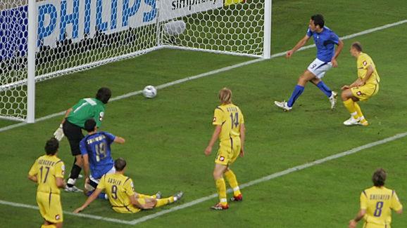Italian forward Luca Toni (blue jersey,