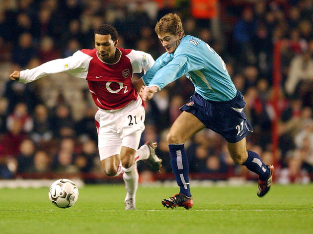 Jermaine Pennant of Arsenal and George McCartney of Sunderland