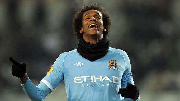 Manchester City's Jo (front) celebrates