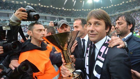 Juventus' coach Antonio Conte (R) holds