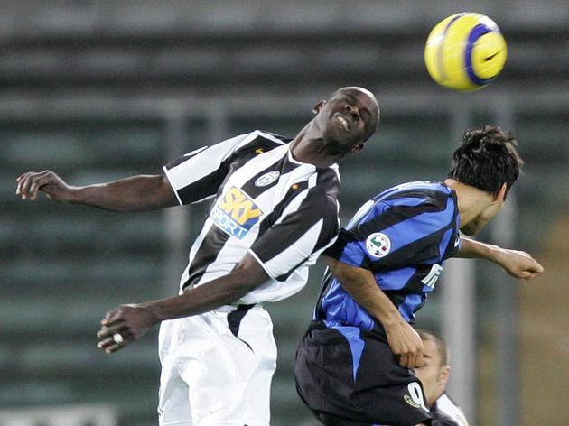 Juventus' defender Lilian Thuram vies wi