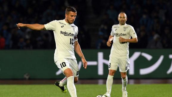 Lukas Podolski,Andres Iniesta