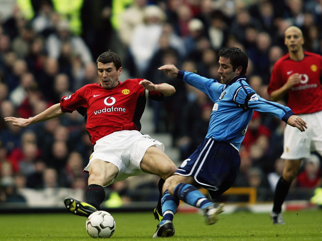 Kevin Horlock of Manchester City and Roy Keane of Manchester United