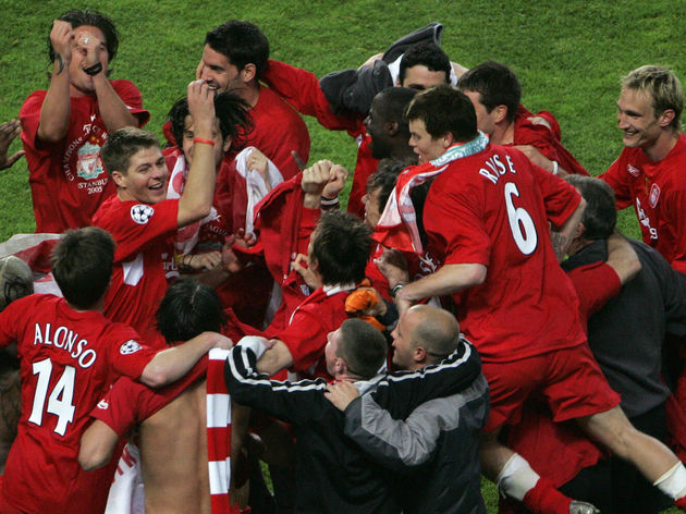 Liverpool players celebrate after winnin