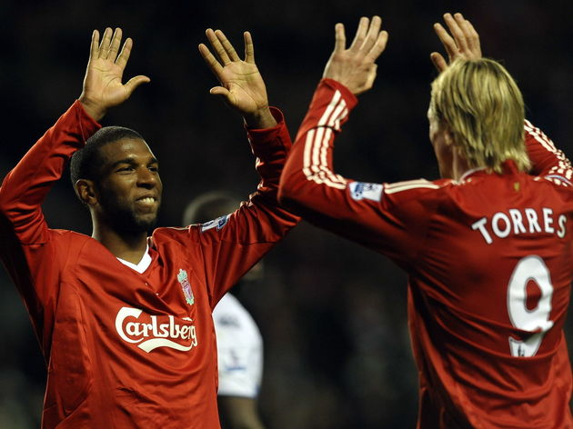 Liverpool's Dutch forward Ryan Babel (L)
