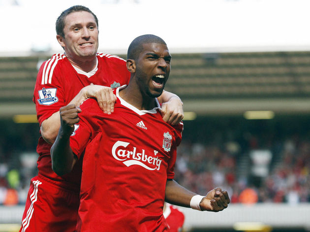 Liverpool's Dutch forward Ryan Babel (R)