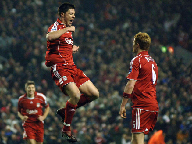 Liverpool's Xabi Alonso (L) celebrates w