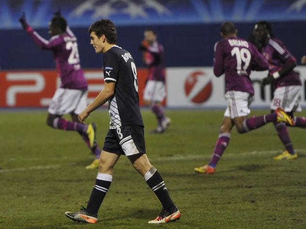 Lyon's players celebrate after scoring a