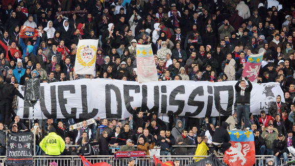 Lyon's supporters hold a banner calling