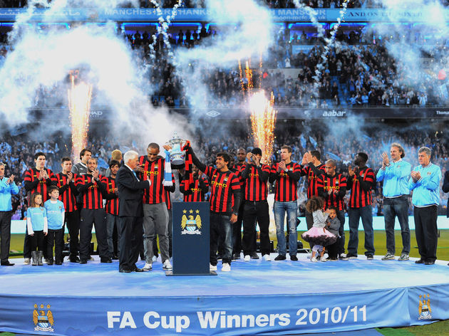 Manchester City players celebrate at the