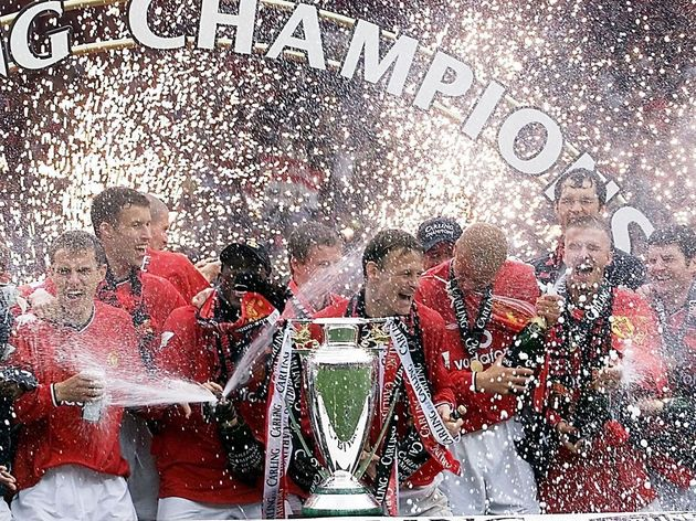 Manchester United players spray champagne as firew