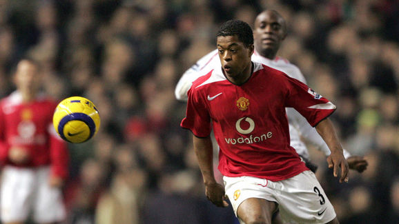 Manchester United's Patrice Evra is chal