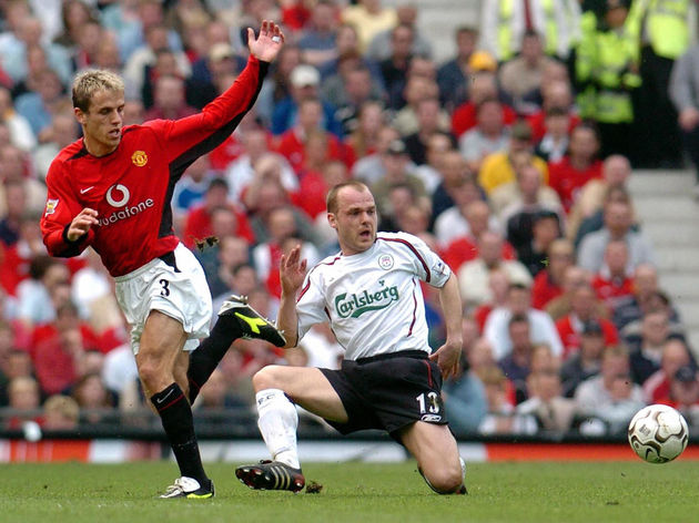 Manchester United's Phil Neville (L) and