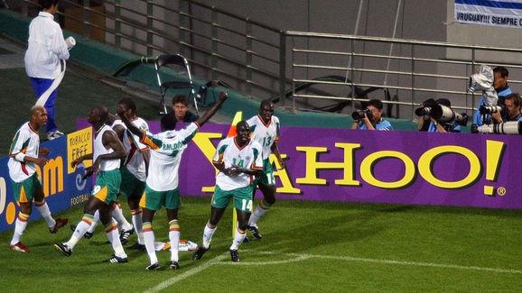 Members of the Senegal team celebrate after midfie