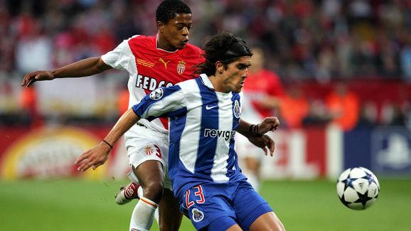 Monaco's defender Patrice Evra (L) tries