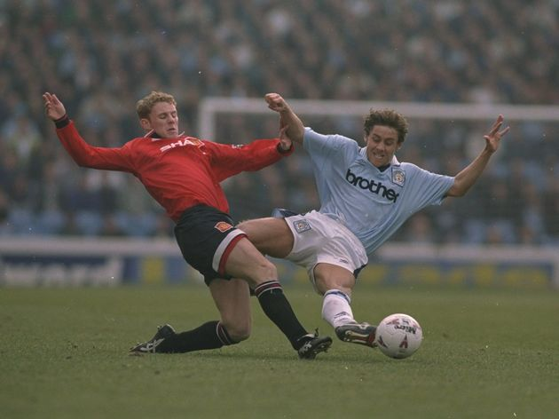 Nicky Butt of Manchester United and Michael Brown of Manchester City