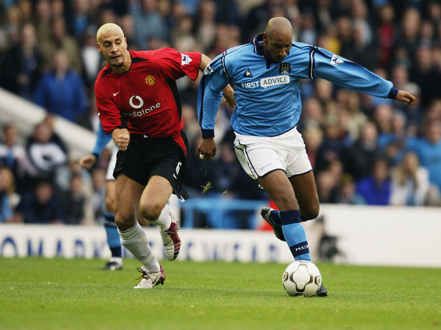 Nicolas Anelka of Manchester City and Rio Ferdinand of Manchester United