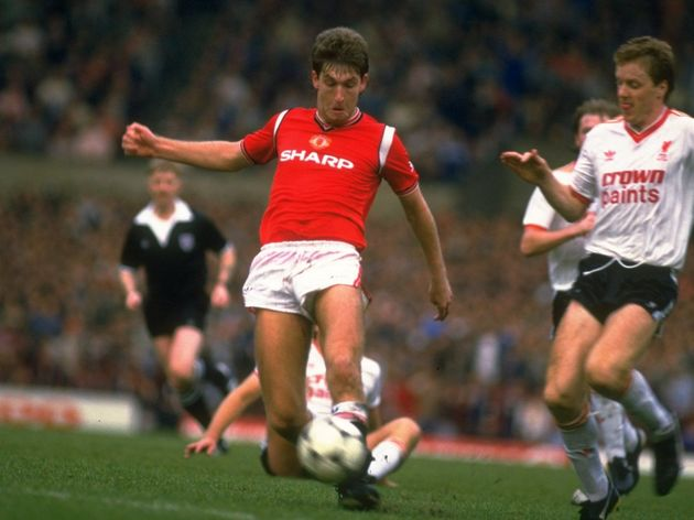 Norman Whiteside of manchester United and Steve Nicholl of Liverpool
