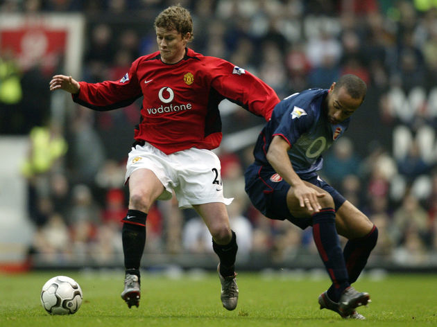 Ole Gunnar Solskjaer of Manchester United and Thierry Henry of Arsenal