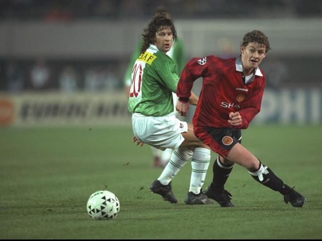 Ole Gunnar Solskjaer of Manchester United (right) turns Andreas Heraf