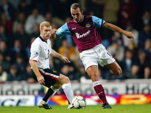 Paolo Di Canio of West Ham United and Paul Scholes of Manchester United