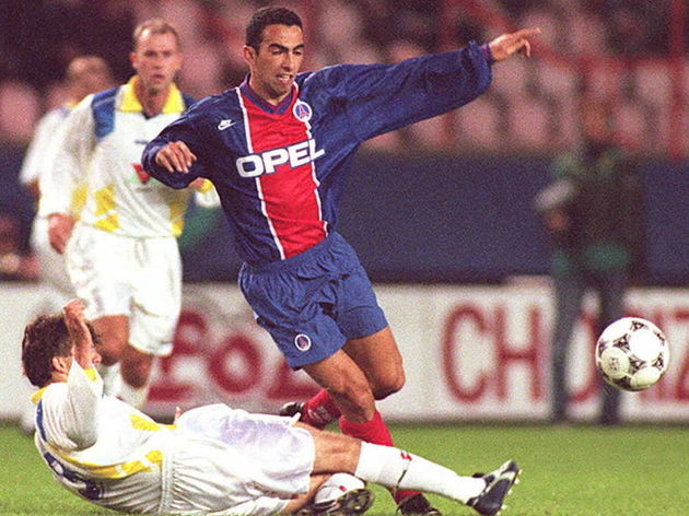 Paris Saint-Germain's Youri Djorkaef (R) is tackle