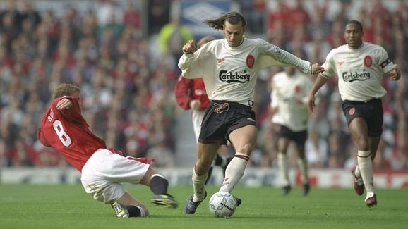 Patrik Berger of Liverpool (right) goes around a sliding Nicky Butt of Manchester United