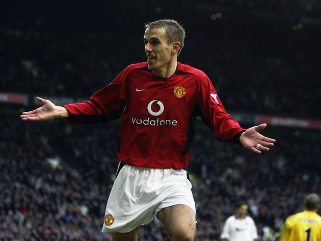 Phil Neville of Manchester United celebrates scoring the fourth goal of the match