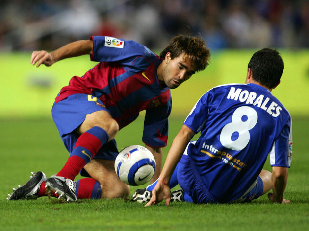 RCD Espanyol's Morales (R) vies for the