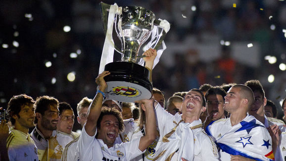 Real Madrid's players hold the Spanish L