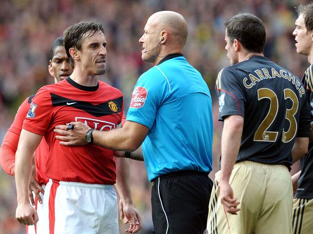 Referee Howard Webb holds Manchester Uni