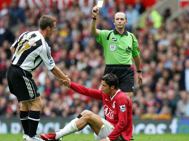 Referee Mike Dean cautions Newcastle Uni