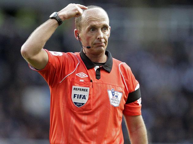 Referee Mike Dean gestures during the En