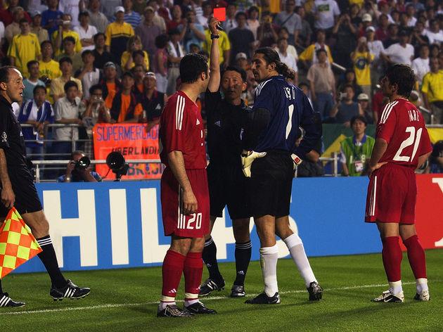 Referee Young Joo Kim of South Korea and  Hakan Unsal of Turkey