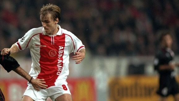 Richard Witschge of Ajax tackles a Olympiakos player