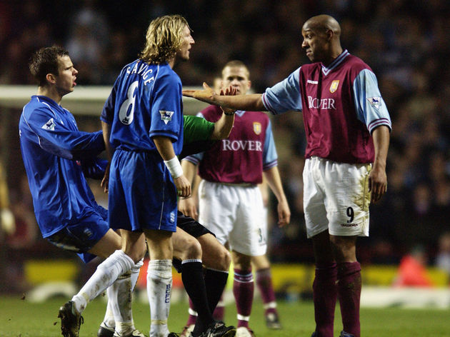 Robbie Savage of Birmingham City argues with Dion Dublin of Aston Villa