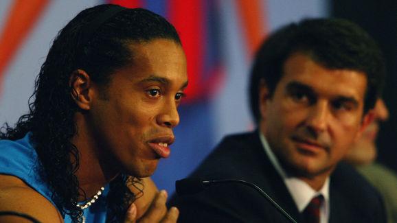 Ronaldinho of Brazil with the president of Barcelona FC Joan Laporta talking to the press