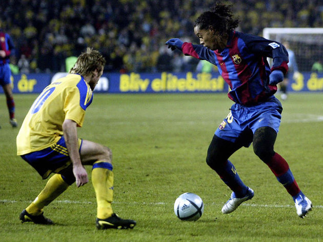 Ronaldinho, right, of F.C. Barcelona out
