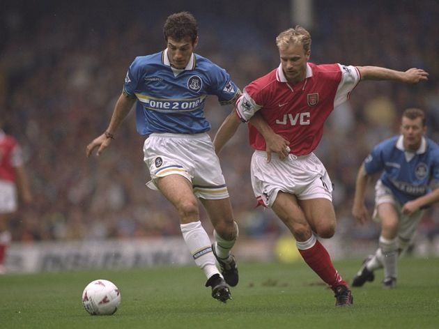 Slaven Bilic of Everton and Dennis Bergkamp of Arsenal