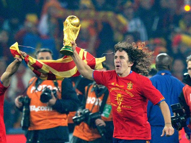Spain's defender Carles Puyol runs with