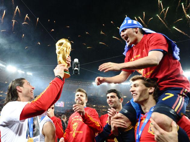 Spain's defender Sergio Ramos (L) hands