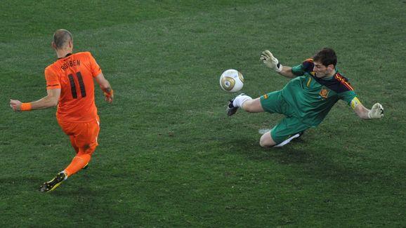 Spain's goalkeeper Iker Casillas (R) pul