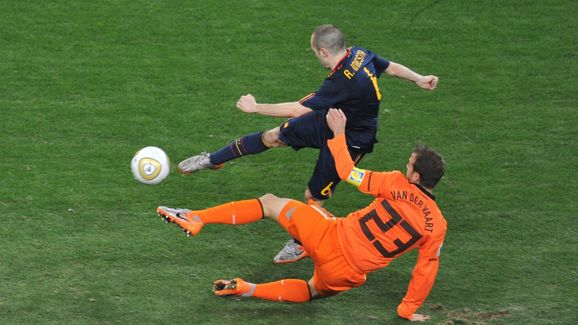 Spain's midfielder Andrés Iniesta (back)