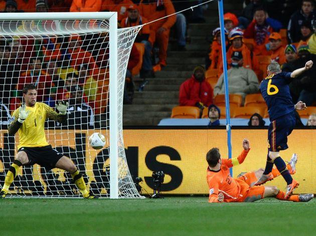 Spain's midfielder Andrés Iniesta (R) sh