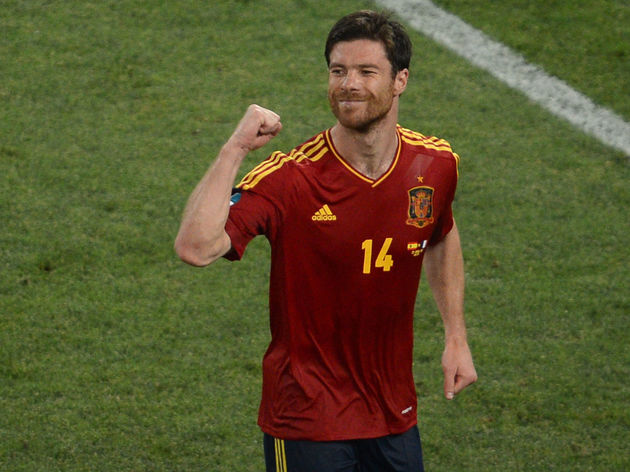 Spanish midfielder Xabi Alonso celebrate