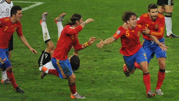Teammates celebrate with Spain's defende