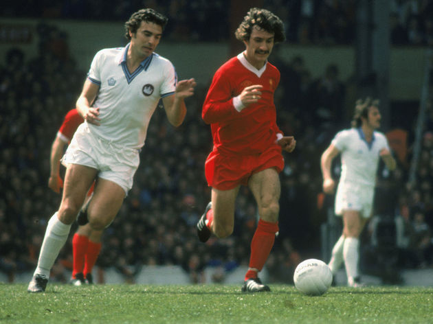 Terry McDermott of Liverpool and Trevor Brooking of West Ham United