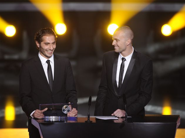 Turkish Hamit Altintop (L) receives the