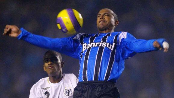 Tuta (R) of Brazil's Gremio vies with Ad...